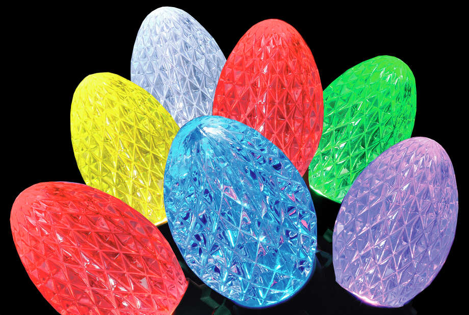 Each iTwinkle G35 bulb holds three LEDs — red, green and blue — that can be combined to create thousands of color choices. Photo: Associated Press / GE
