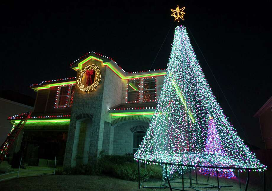 Jeff Womack and his family set up a glowing holiday display with about 75,000 lights at their home in Schertz. Photo: Darren Abate, For The Express-News / San Antonio Express-News