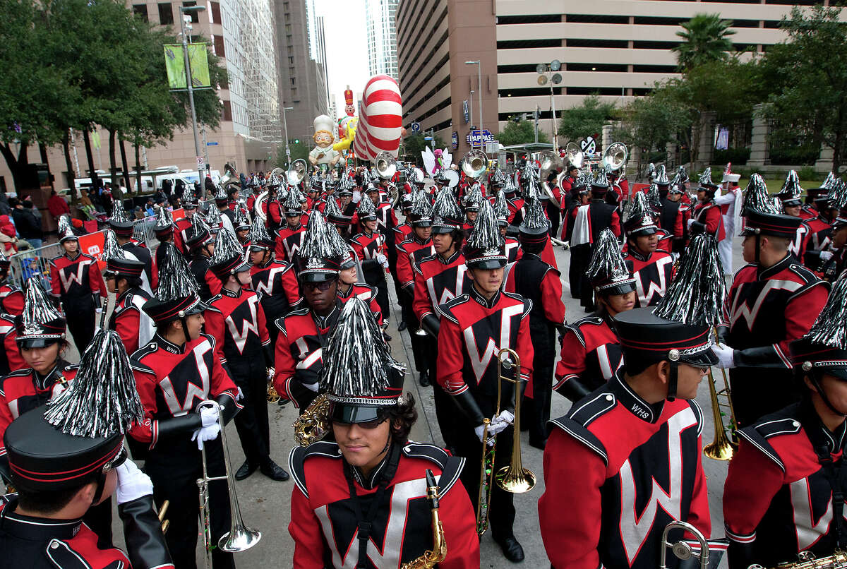 Participants prepare for the 64th annual Thanksgiving Day Parade along Smith Street, Thursday, Nov. 28, 2013, in Houston. (Cody Duty / Houston Chronicle)