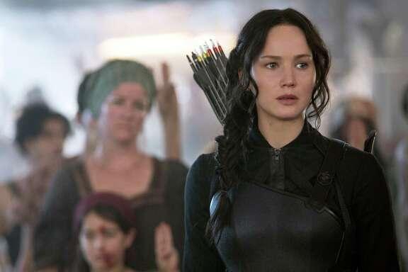"Jennifer Lawrence portrays Katniss Everdeen in ""The Hunger Games: Mockingjay Part 1."""