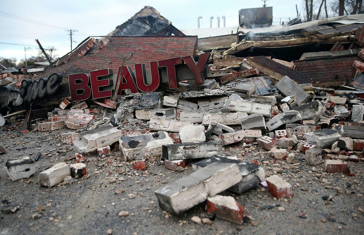 A sign sits amidst rubble at a building that was damaged during a demonstration in Dellwood, Missouri. Demonstrators caused extensive damage in Ferguson and surrounding areas last night after a St. Louis County grand jury decided to not indict Ferguson police Officer Darren Wilson in the shooting of Michael Brown.