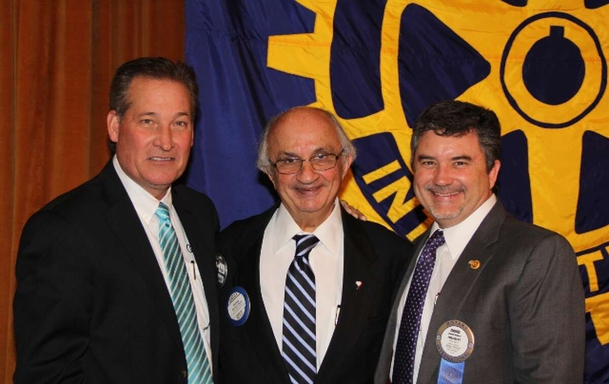 Rick Cavender, from left, Harvey Najim and David Ballard at the weekly luncheon of the Rotary Club of San Antonio at the Scottish Rite Banquet Hall.