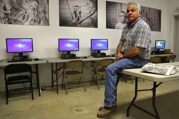 Harvey Mireles, Director of San Anto Cultural Arts, sits in the new building at San Anto Cultural Arts. Tuesday, Nov. 4, 2014.