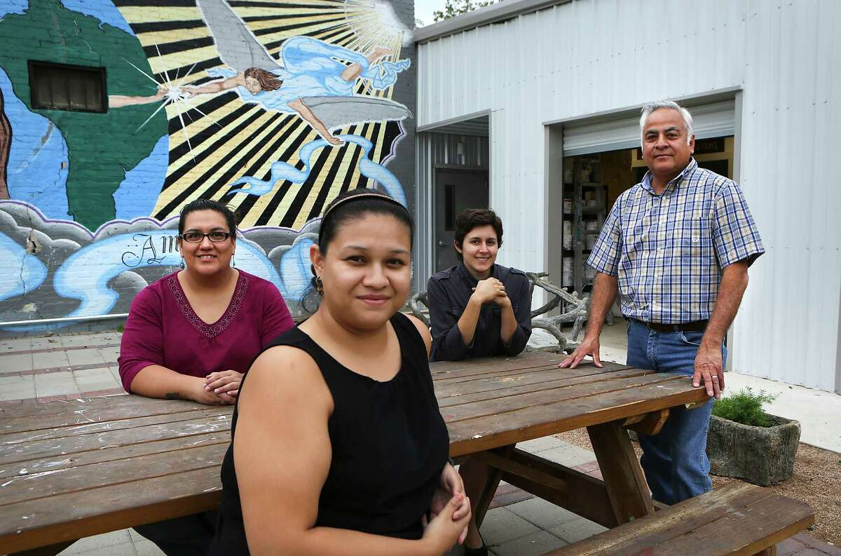 Cecilia Santos (from left) public art manager of San Anto Cultural Arts; Samantha Lopez, outreach manager; Caroline Tonarely, programs assistant; and Harvey Mireles, director, sit outside the new addition to their building on the West Side.
