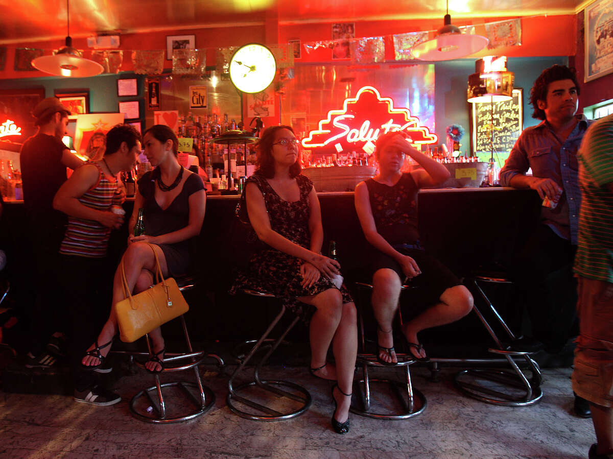 Salute (From center left) Jorge Gonzalez, Sarah Gould, Michelle Baland and Michele Nicole Simpson sit at the bar while listening to hip hop group Chisme play Sunday July 8, 2012 at Salute. The legendary nightclub hosted its last live event on July 21, 2012.