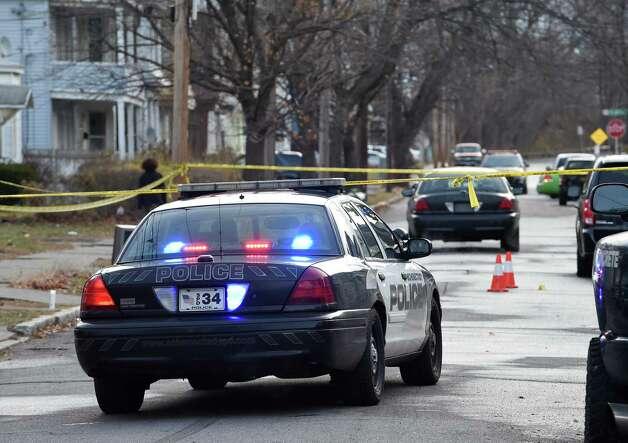 Police secure the scene of a murder in the 800 block of Bridge Street Nov.2 5, 2014 in Schenectady, N.Y.     (Skip Dickstein/Times Union) Photo: SKIP DICKSTEIN