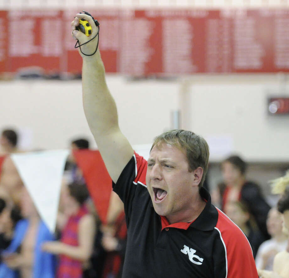 New Canaan swim coach Dave Fine during the FCIAC Swimming championships at Greenwich High School, Thursday night, Feb. 28, 2013. Photo: Bob Luckey / Greenwich Time