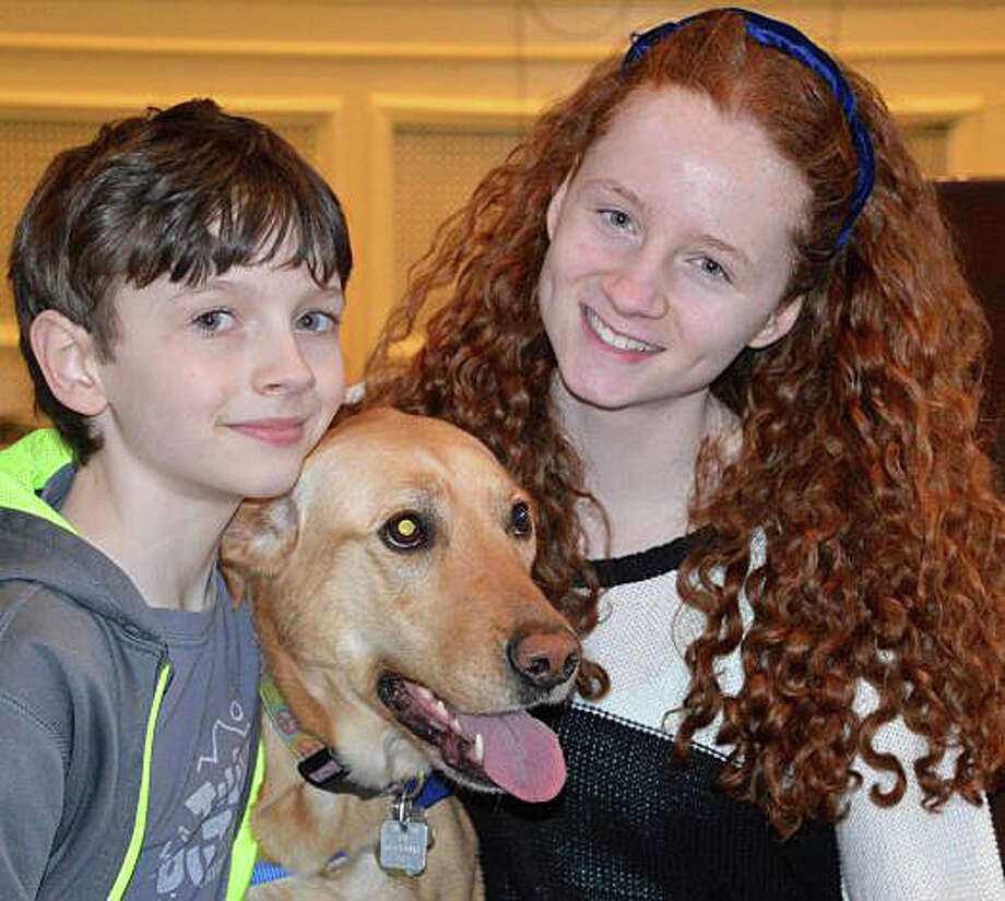 Cali, a rescued yellow lab mix, was named Westport's Top Dog last year in the annual contest sponsored by Westport Animal Shelter Advocates. Here, she shares the honor with owners brother and sister Brandon and Madison Malin. Photo: File Photo / Westport News