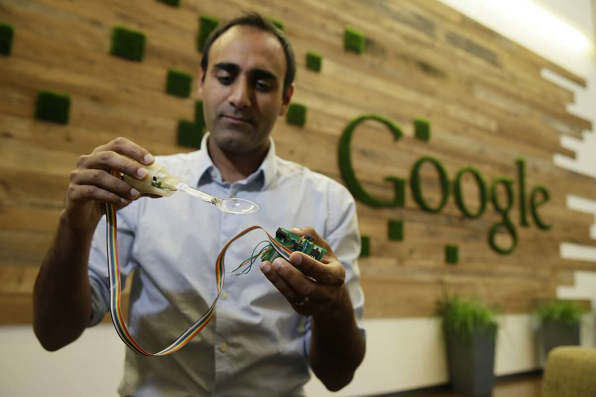 In this photo taken Friday, Nov. 21, 2014, Anupam Pathak, a senior hardware engineer at Google, shows off the prototype of the Liftware Spoon he developed that helps people eat without spilling in Mountain View, Calif. Just in time for the holidays, Google is throwing it's money, brain power and technology at the humble spoon. Not surprisingly, the company that has brought the driverless car and Internet glasses is bringing a unique improvement to the utensils. Built with hundreds of algorithms, these specially designed spoons make it much easier for people with tremors and Parkinson's Disease to eat without spilling. The spoons sense a shaking hand and make instant adjustments to stay balanced. (AP Photo/Eric Risberg)