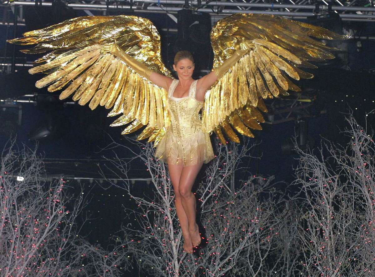 A model protraying an angel flies through the air during the Victoria's Secret Christmas Dreams and Fantasies 2001 fashion show November 13, 2001 at Bryant Park in New York City.