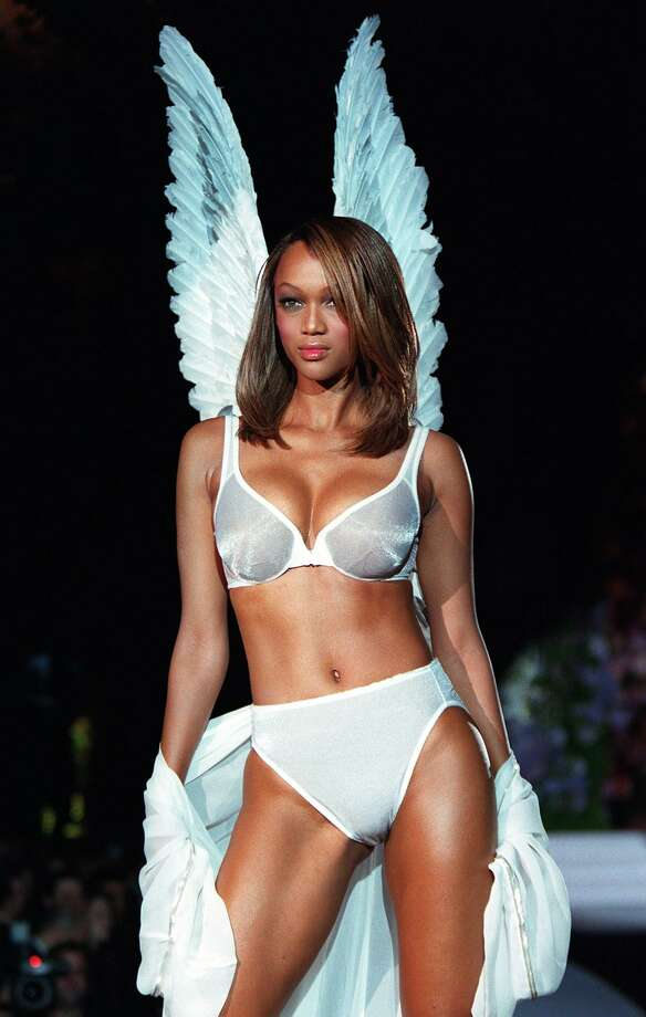 04a27650124 Model Tyra Banks wears a white Angel bra and matching panties with white  Angel wings during