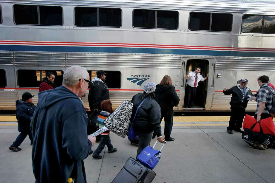 Passengers at the Martinez Amtrak Station rush to their Zephyr train, though often they get sidetracked and wait while freight trains get the right-of-way. Photo: Brant Ward / The Chronicle / ONLINE_YES