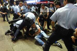Hong Kong police arrest 116, clash with protesters - Photo