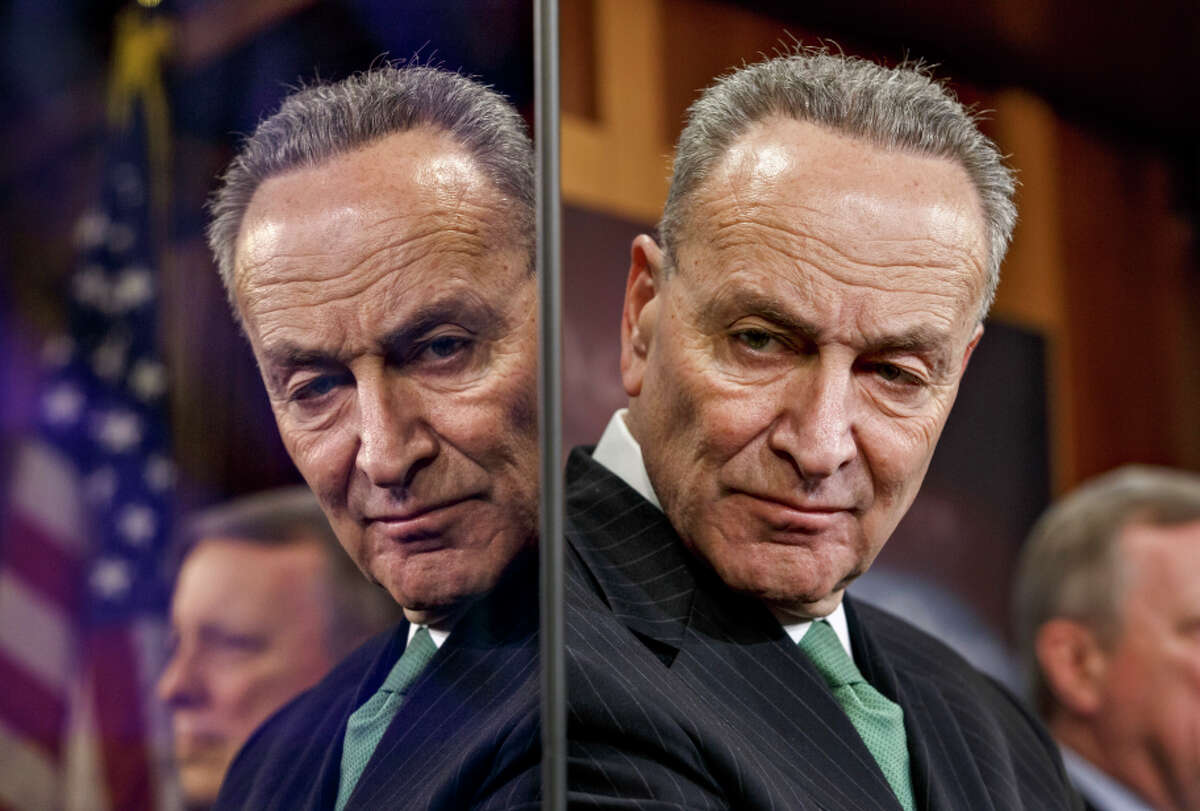 Sen. Chuck Schumer, reflected in a TV monitor in February, says Democrats should have focused on jobs in 2009.