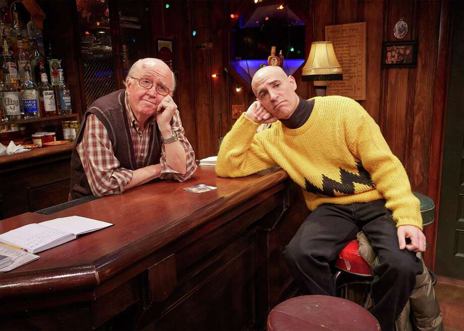 "Bartender Ron Carroll commiserates with a grown-up Charlie Brown (Harry Bouvy) in ""Christmas on the Rocks,"" the holiday comedy at TheaterWorks Hartford through Dec. 21. Photo: Contributed Photo / Connecticut Post Contributed"