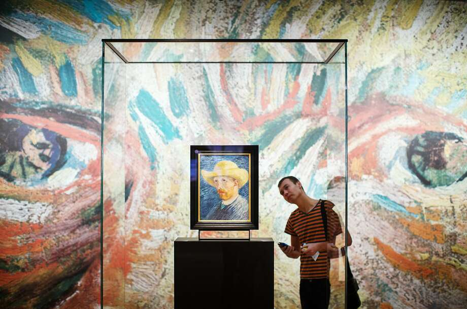 AMSTERDAM, NETHERLANDS - NOVEMBER 25:  A visitor looks at a self portrait of Dutch Post-Impressionist painter Vincent van Gogh on the ground floor of the Vincent van Gogh museum on November 25, 2014 in Amsterdam, Netherlands. The new presentation of the permanent collection of Vincent van Gogh (1853-1890) works focuses on the development of the artist and the myths surrounding Van Gogh's suicide, illness and ear are discussed in detail for the first time at the museum. On the ground floor of the museum, visitor's first walk through an array of the Dutch artist's self-portraits.  (Photo by Jasper Juinen/Getty Images) *** BESTPIX *** Photo: Jasper Juinen, Getty Images