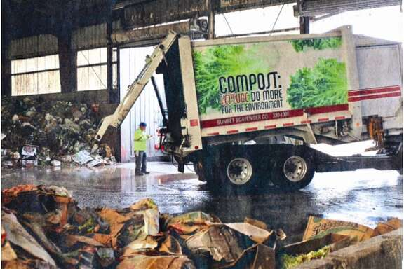 A Recology truck delivers food waste to a composting facility.