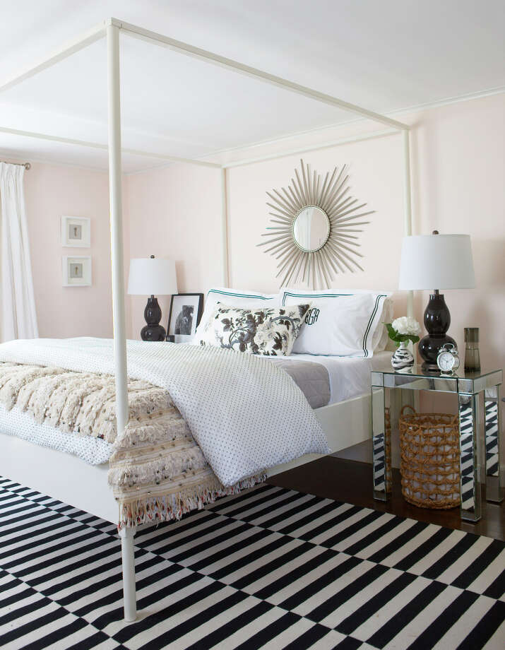 In the guestroom of her house, one of Erin Gates' favorite spaces, the lightest pink (Benjamin Moore Blanched Coral) covers the walls, but the femininity is toned down with graphic black-and-white accents. Photo: Michael Partenio, STR / Washington Post / THE WASHINGTON POST