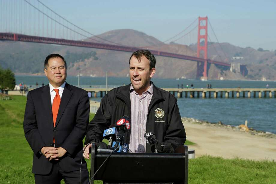 State assembly members Phil Ting, left, and Marc Levine, at podium, speak out against sidewalk tolls with the Golden Gate Bridge in the background during a press conference at Crissy Field Tuesday, Nov. 25, 2014, in San Francisco. The assembly members announced legislation to prevent the Golden Gate Bridge Highway and Transportation District from assessing a sidewalk toll on pedestrians and cyclists crossing the bridge. (AP Photo/Eric Risberg) Photo: Eric Risberg / Associated Press / AP