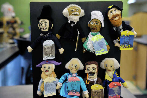 Finger puppets of historical figures  are seen on display in the new Empire State Plaza Visitor Center on Monday, Nov. 24, 2014, in Albany, N.Y.  The new center will be the place for people to shop for gifts, to get visitor information and to get information on tours of the Capitol or tours of the executive mansion.  (Paul Buckowski / Times Union) Photo: Paul Buckowski, Albany Times Union / 00029616A