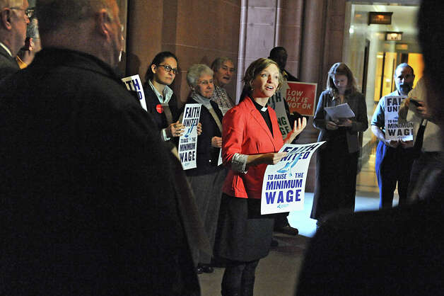Rev. Frances Rosenau, associate pastor of Westminster Presbyterian Church, speaks as community, faith and labor leaders advocate for raising the minimum wage for workers in New York State at the Capitol on Tuesday, Nov. 25, 2014 in Albany, N.Y.  (Lori Van Buren / Times Union) Photo: Lori Van Buren, Albany Times Union / 00029623A