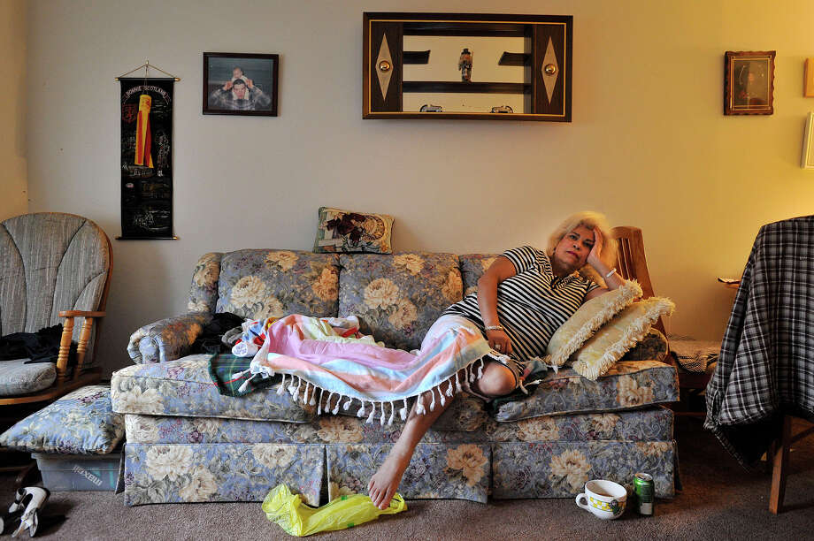 Eleanor Roosevelt House resident Rikia Ramina Belmali, 64, poses on the friend's couch she is forced to sleep on in her building on Knapp Street in Stamford, Conn., on Tuesday, Nov. 25, 2014. Belmali says because of her health conditions she cannot take the stairs to her sixth floor apartment. The elevator at the elderly apartment building has been broken and unusable for nearly a week. Residents say the elevator has been inoperable on and off for the past few months. Photo: Jason Rearick / Stamford Advocate