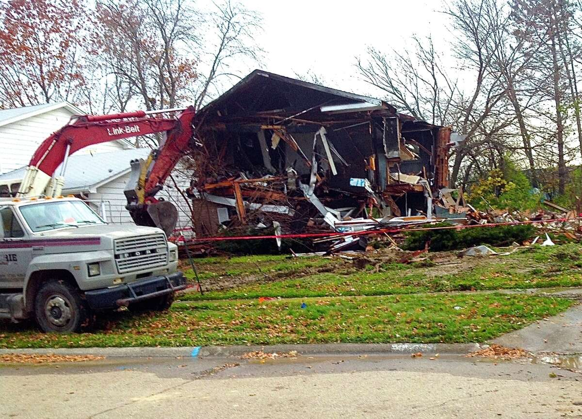 Crews demolish a home in Flint, Mich., that Gordon Young funded through Indiegogo, raising more than $11,113 to ease neighborhood blight.
