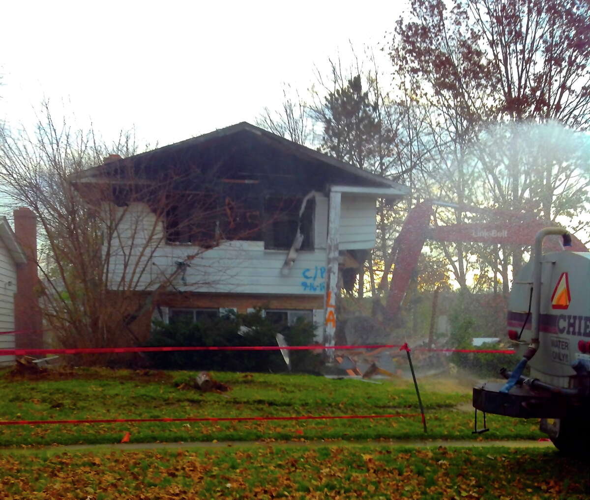 Crews demolish a Flint, Mich. home. The demolition was funded through a crowd-funding online site, Indiegogo
