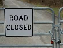 File photo of a sign on a gate erected on Carola Lane, New Fairfield, Conn.