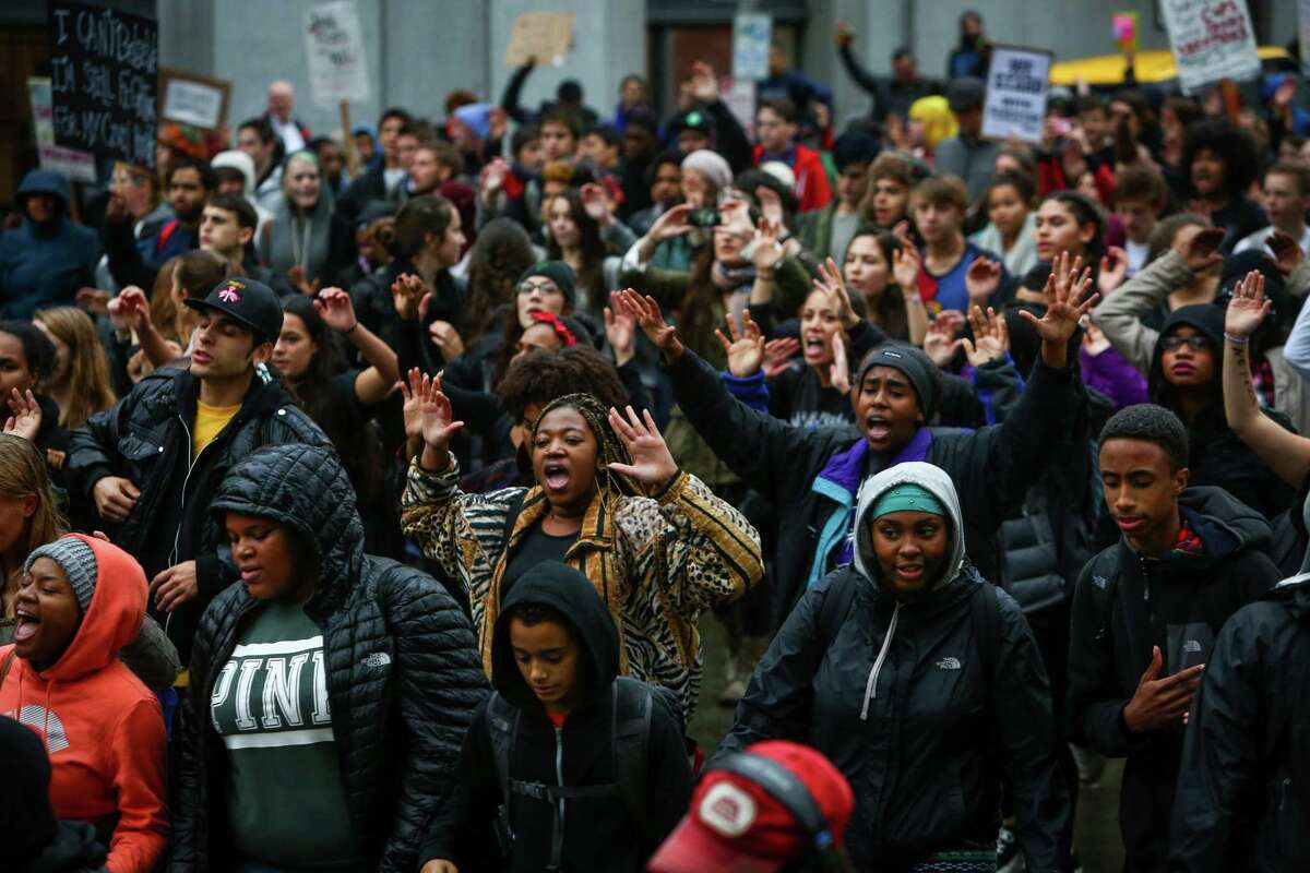 Students from Garfield High School, faith leaders and others march in downtown Seattle to protest the grand jury decision not to indict a Ferguson, Missouri police officer that killed an unarmed black teenager.