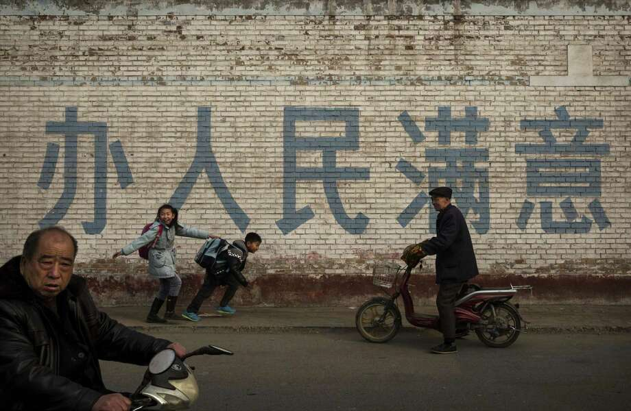 Students walk to school in Hebei, China. Researchers base much of Chinese students' testing success on teaching methods the West has been abandoning. Photo: Kevin Frayer / Kevin Frayer / Getty Images / 2014 Getty Images