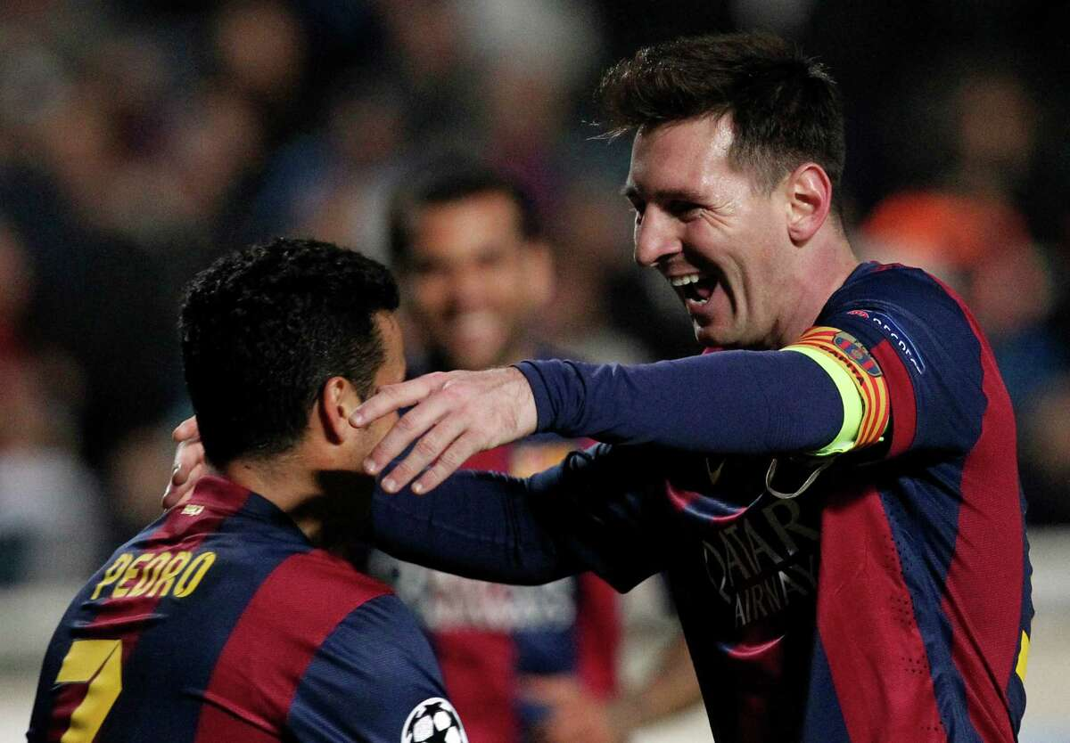 Lionel Messi (right) celebrates with a teammate after scoring Barcelona's fourth goal in a victory in Nicosia, Cyprus.