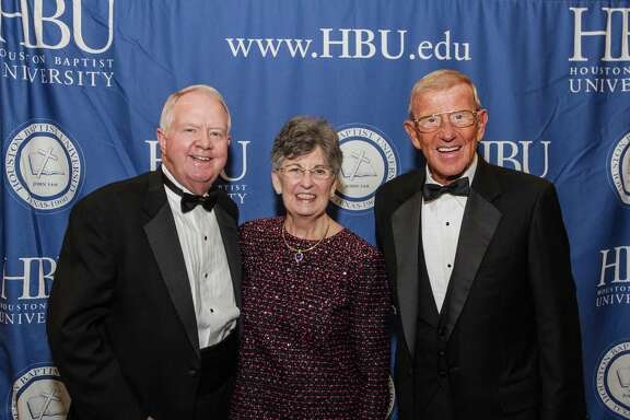 Archie and Linda Dunham, from left, with Lou Holtz