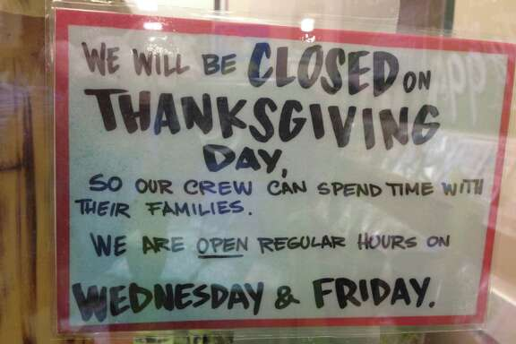 A sign at the Trader Joe's at Shepherd and West Alabama alerts shoppers that it will be closed for Thanksgiving.
