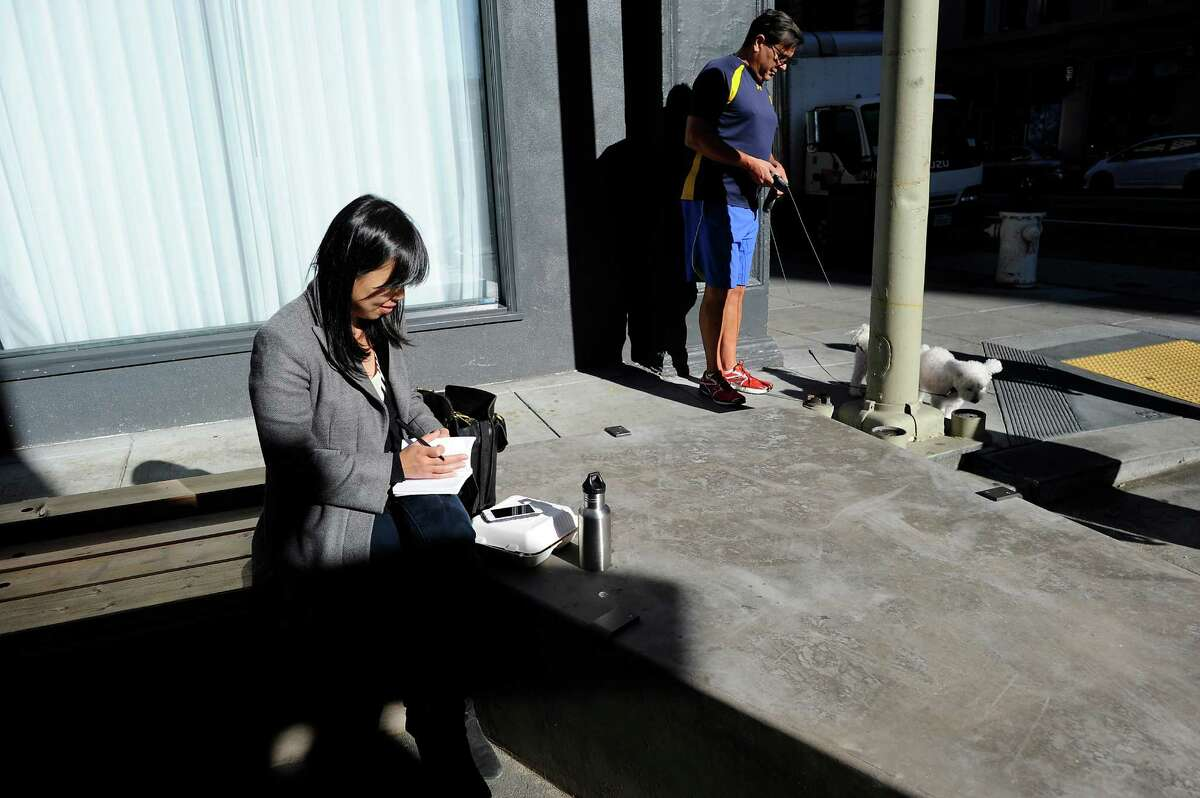 Amy Yu Gray, left, takes her lunch break from working at nearby SFMOMA offices at the newly designed, pedestrian friendly plaza on Annie Street in San Francisco CA, on Monday, November 24, 2014.