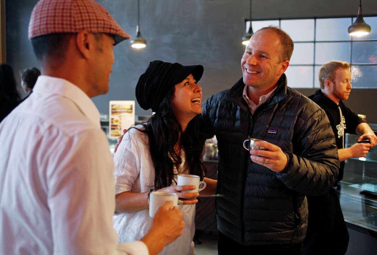 Mission Heirloom owners Bobby Chang (left) and Yrmis Barroeta celebrate the opening day of Vine + Shattuck cafe with cafe landlord Ito Ripsteen.
