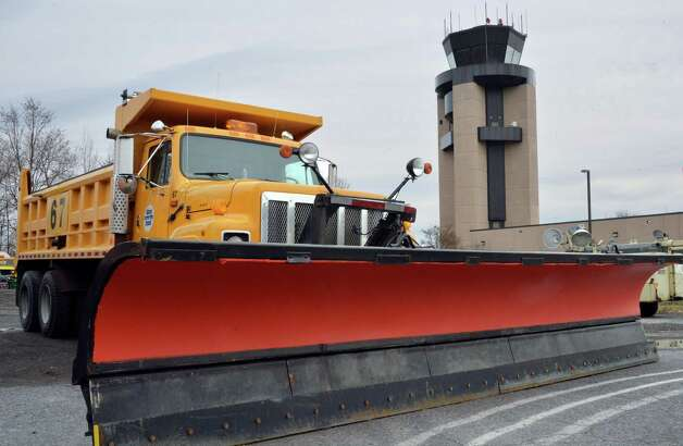 A snow plow stands ready for the upcoming snow storm at Albany International Airport Tuesday Nov. 25, 2014, in Colonie, NY.  (John Carl D'Annibale / Times Union) Photo: John Carl D'Annibale, Albany Times Union / 00029624A