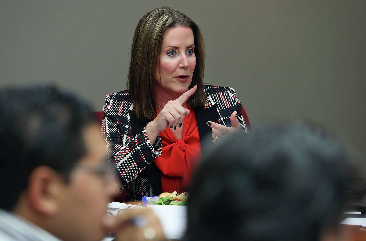 Community volunteer Mary Jo Grundhoefer heads the non-profit Hope for the Future board meeting on October 30, 2014.