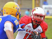 Caleb Berry runs the ball during the game between the Lamar Cardinals and the McNeese State University Cowboys at Cowboy Stadium in Lake Charles, November 22, 2014. Photo provided by Kyle Ezell