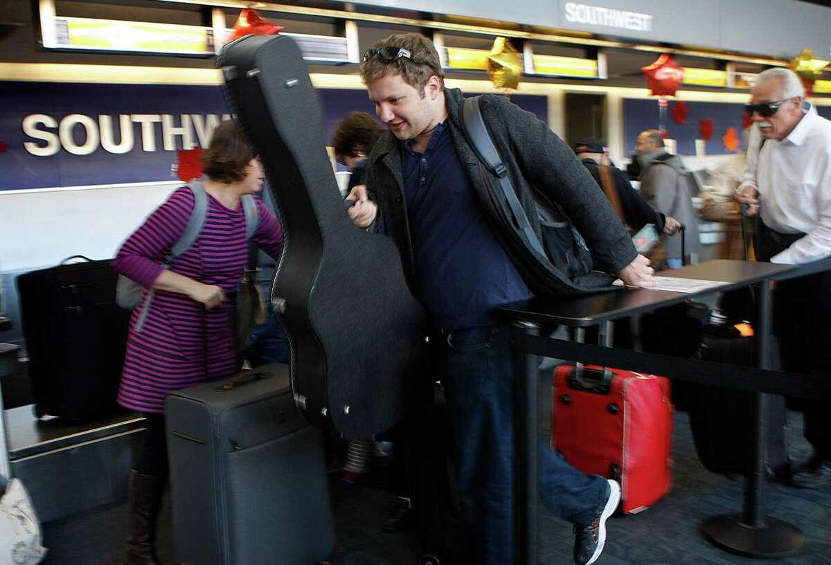 Alex Enger of San Francisco catches a Thanksgiving flight for Atlanta at San Francisco International Airport.