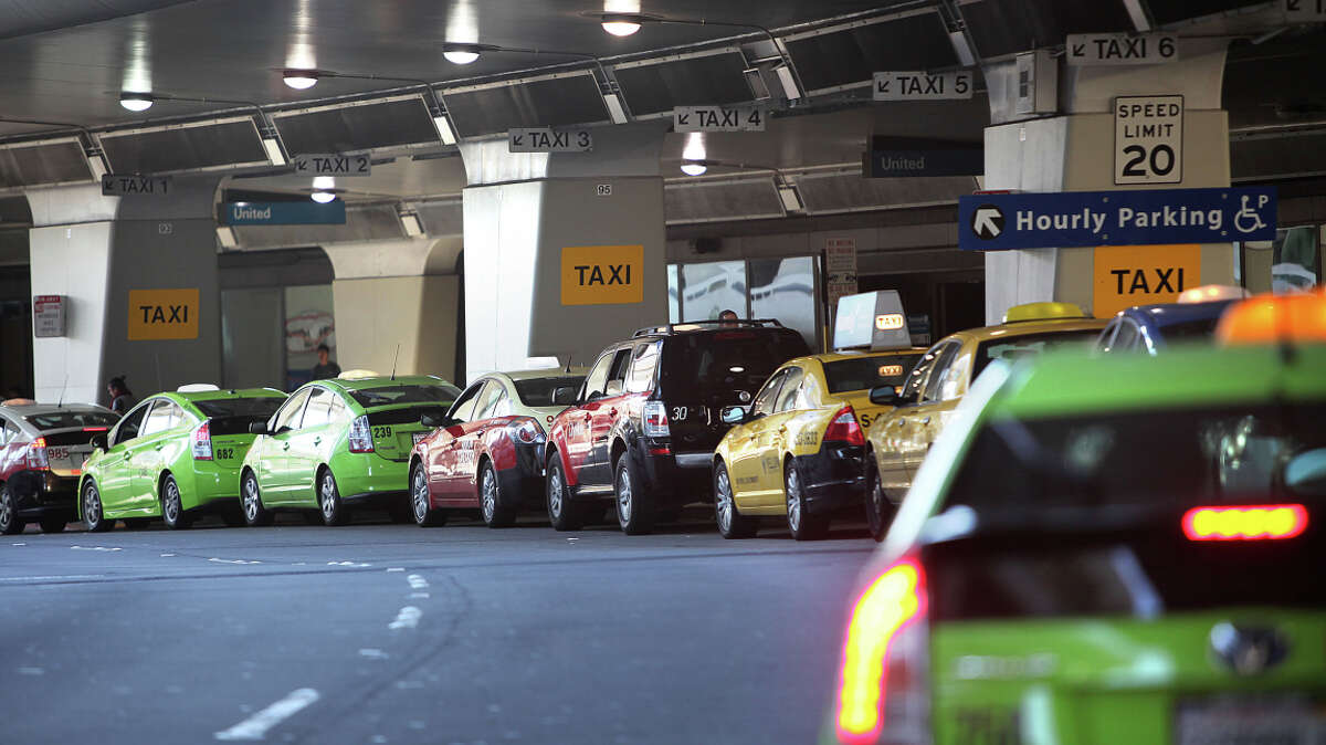 Taxis line up at San Francisco International Airport, whose director says he doesn't expect threatened protests to disrupt holiday travel. Taxi drivers object to ride services using the airport.
