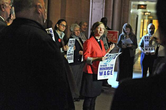 Rev. Frances Rosenau, associate pastor of Westminster Presbyterian Church, speaks as community, faith and labor leaders advocate for raising the minimum wage for workers in New York State at the Capitol on Tuesday, Nov. 25, 2014 in Albany, N.Y.  (Lori Van Buren / Times Union) Photo: Lori Van Buren / 00029623A