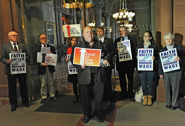 Mark Emanatian of Citizen Action speaks as community, faith and labor leaders advocate for raising the minimum wage for workers in New York State at the Capitol on Tuesday, Nov. 25, 2014 in Albany, N.Y.  (Lori Van Buren / Times Union) Photo: Lori Van Buren / 00029623A