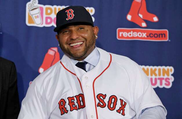 Newly acquired Boston Red Sox free agent third baseman Pablo Sandoval smilies as he is introduced to the media at Fenway Park Tuesday, Nov. 25, 2014, in Boston. (AP Photo/Stephan Savoia) ORG XMIT: MASS103 Photo: Stephan Savoia / AP