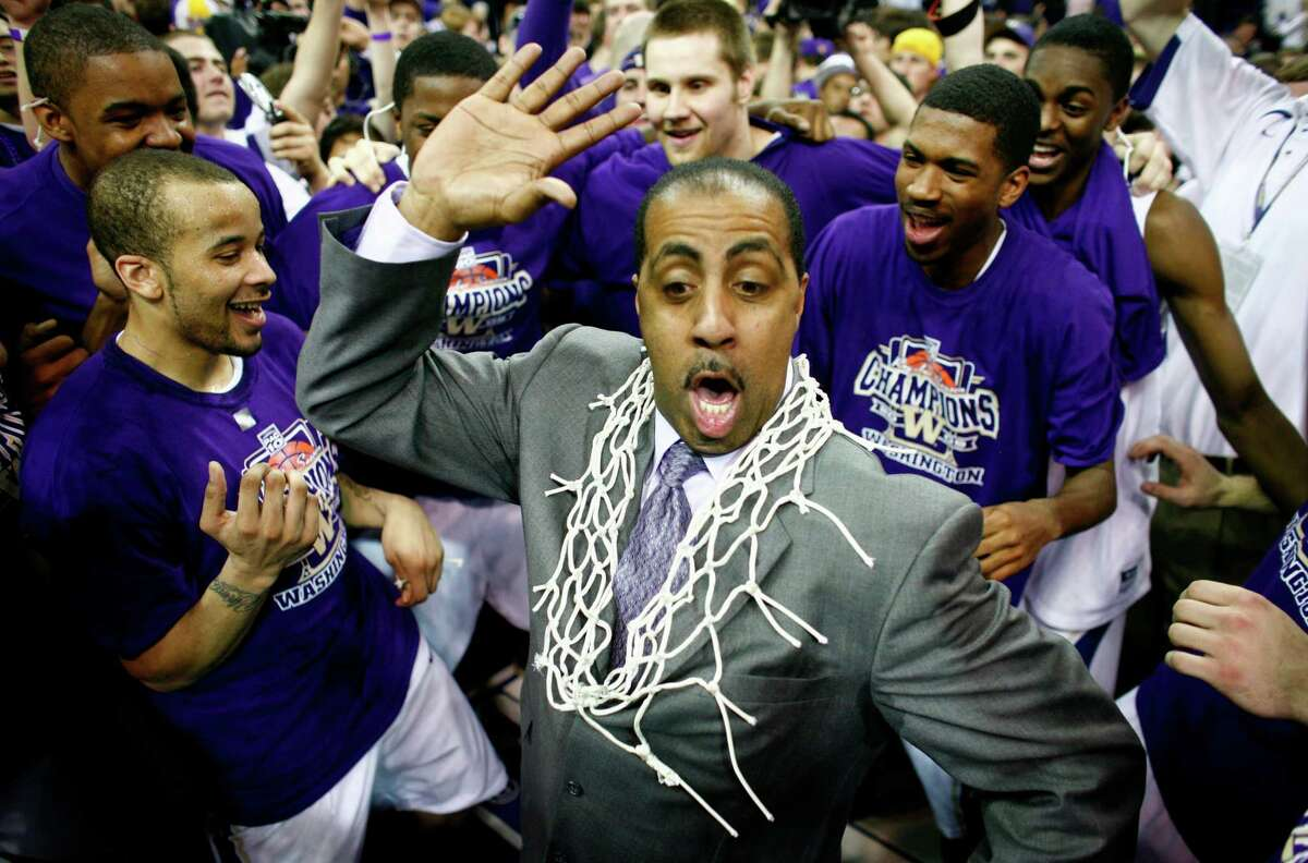 University of Washington men's basketball coach Lorenzo Romar dances with his players after the team secured the PAC 10 title during a game against Washignton State University on March 7, 2009 at Hec Ed Pavilion.