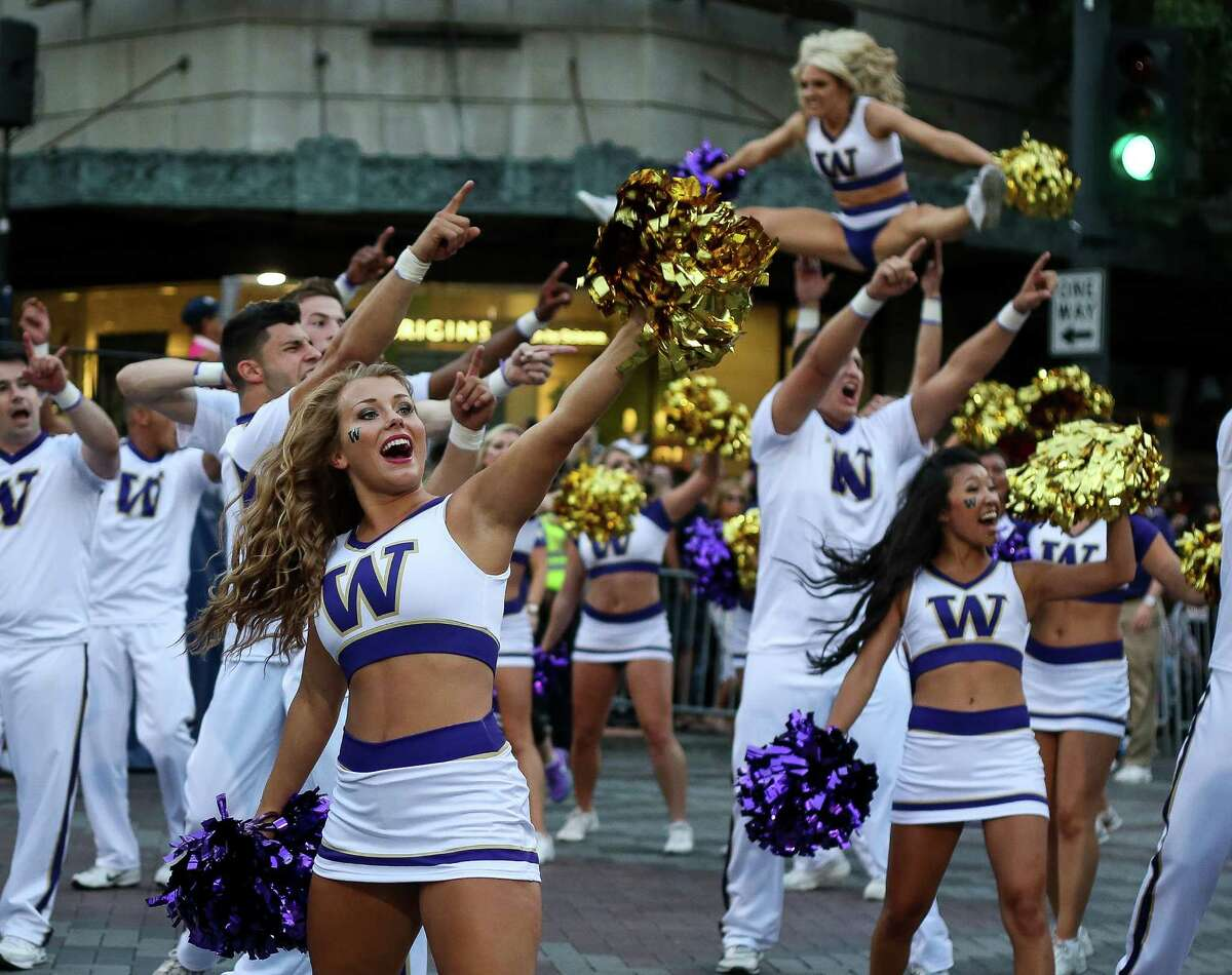 Founded in 1861, the University of Washington is consistently ranked among top universities. Here's a look at UW student life through the years. Photo: UW cheerleaders perform at Seafair Torchlight Parade on July 26, 2014.
