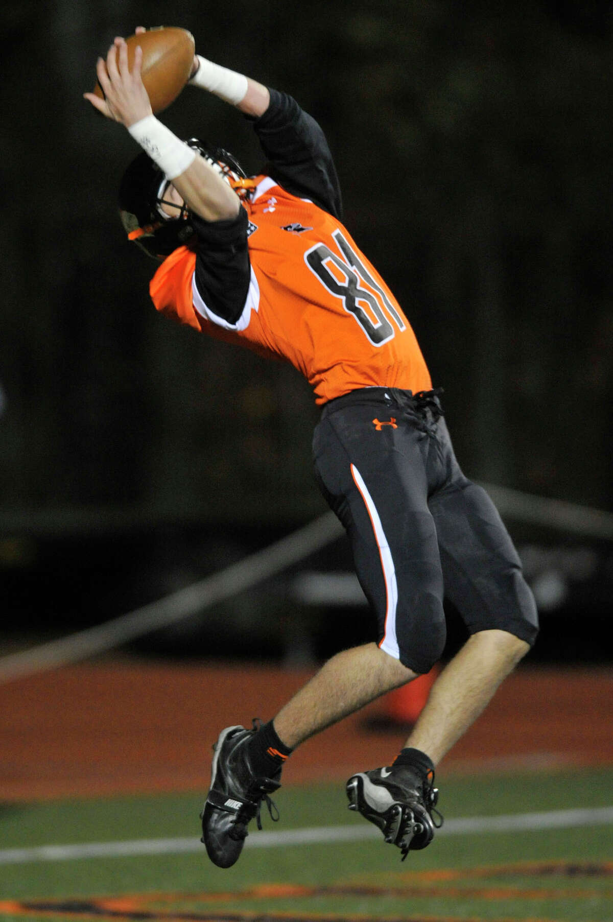 Stamford's Billy Devito makes a leaping touchdown catch with seconds left in the half during the Black Knights' football game against Westhill at Stamford High School in Stamford, Conn., on Tuesday, Nov. 25, 2014. Stamford won, 42-21.