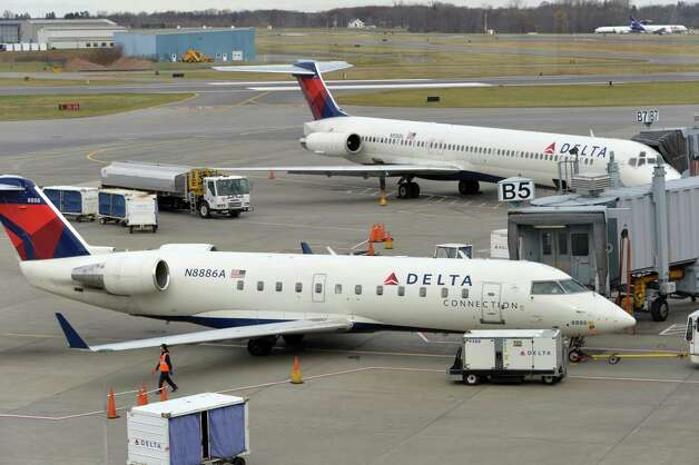 Planes at the Deltagates at Albany International Airport Tuesday Nov. 25, 2014, in Colonie, NY.  (John Carl D'Annibale / Times Union) Photo: John Carl D'Annibale / 00029624A