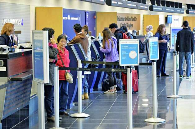 Passengers at the ticket counters at Albany International Airport Tuesday Nov. 25, 2014, in Colonie, NY.  (John Carl D'Annibale / Times Union) Photo: John Carl D'Annibale / 00029624A