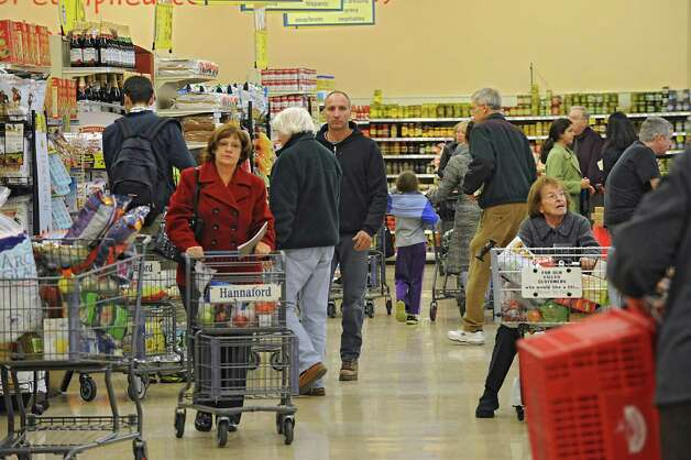 Shoppers pack the Hannaford in Latham Farms on Tuesday, Nov. 25, 2014 in Latham, N.Y. People are getting ready for a snow storm tomorrow and then Thanksgiving on Thursday. (Lori Van Buren / Times Union) Photo: Lori Van Buren